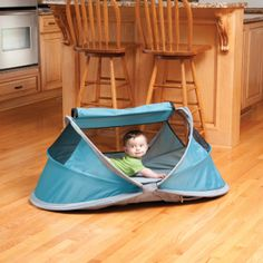 A genius little tent with a self-inflating mattress that provides a safe and cozy sleeping area for a baby or toddler while traveling.  Great for the outdoors.