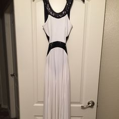 White and Black Prom/Evening dress Black and white prom dress. Only worn once. The black part has sequins for a sparkly touch. It's open back. Very sexy and flattering. *PETITE* Betsy & Adam Dresses Prom