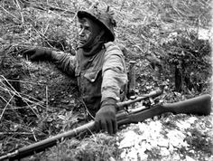 Canadian soldier with a P-14 Enfield rifle with scope, on a training exercise in England, 23 Apr 1943. (Library and Archives Canada Photo, MIKAN No. 3596209)