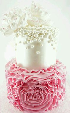 Pink ruffles and white pearls wedding cake.