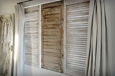 I hung mismatched shutters inside the frame of the large window to add visual interest. They are on hinges so they swing open to allow fresh air inside.