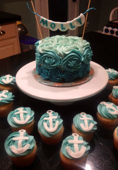 Turquoise cake with anchor cupcakes