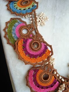 LOOT: MAD about Jewelry 7 DAYS AND COUNTING! LOOT 2013 IS UPON US!!   Featured artist of the day is: Patricia Herrera. She creates bright, intricately woven designs inspired by the work of meticulous lace-makers she encountered while traveling through Asia Minor.