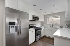 Contemporary Kitchen with European Cabinets, Simple Granite, Galley, Hardwood floors, Arctic White Quartz, High ceiling