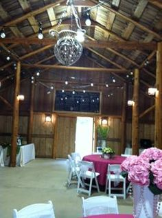 Fern Hollow inside barn with pink tableclothes