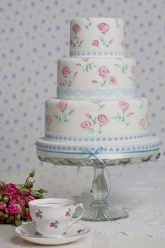 Hand-painted roses on this cake, from Rachelles Beautiful Bespoke Cakes.