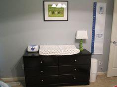 Grey nursery with dark furniture