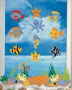 decorazioni-estive-finestre-bambini-personaggi-mondo-marino-ritagli-attaccati-filo