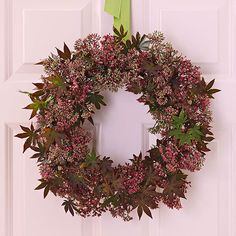 Simple Spring Wreath -Japanese maple and sedum wired to a wreath form produce a pretty wreath for spring that adds natural beauty to your door. Work with your local floral retailer for the supplies, or substitute your own dried spring blooms or faux flowers and leaves. Hang it on your front door with a wide ribbon in a contrasting color, such as the green pictured here.