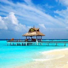 #beach #gazebo on the #Vabbinfaruisland, #Maldives. Built on an almost perfectly round #island, with its elegant villas and #unpretentious #barefoot #luxury, #BanyanTree #Vabbinfaru is a favourite #Maldivian #resort for many #romantic couples and #eco-aficionados. ••• #vacation #travelpic #holidays #sea #sun #blue #indianocean ••• Photo by #Travel+#Style. Our #hotel review: http://www.travelplusstyle.com/hotels/banyan-tree-vabbinfaru