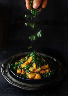 Spicy stir fried potatoes with crunchy spinach