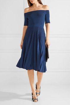 Navy stretch-knit  Slips on 65% viscose, 32% nylon, 3% spandex; lining: 100% silk Dry clean