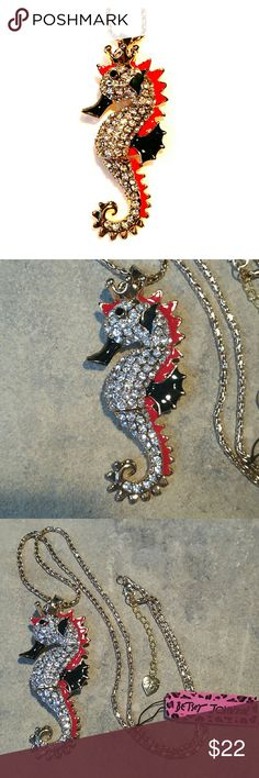 """Red & Black Betsey Johnson Seahorse Necklace NWT New with tags vintage Betsey Johnson king of the ocean seahorse necklace. Very shiny gold metal with red & black enamel, tons of super sparkly crystal rhinestones, and of course a crown on its head. The body is in 3 segments allowing for slight movement and it to really catch the light! Sweater chain with BJ Heart charm on the extension. Chain is 29"""" plus 2"""" extension. Seahorse is 3.5"""" by 1.5"""".   Thank you for checking out my closet, and happy…"""