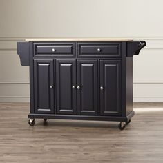 This Kitchen Island is a highly spacious and functional addition to any home. The base of this island is made using manufactured wood and the top is constructed of premium-grade wood for durability. This Kitchen Island is ideal for homes that have traditional interiors. This kitchen island features a towel rack, a spice rack, wheels for portability, two spacious drawers, and three cabinets that have three interior adjustable shelves.