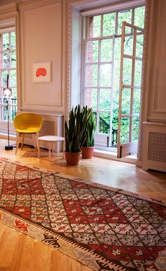 Vintage rugs and carpets from the Middle East and Africa - inspiring vintage kilims, pile rugs and vintage carpets from www.emilyshouselondon.com