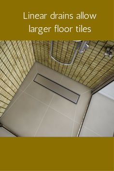 Linear (or sometimes called trench) drains allow the use of larger format tiles in zero threshold roll in showers. More info here - http://innovatebuildingsolutions.com/products/bathrooms/roll-in-handicapped-shower