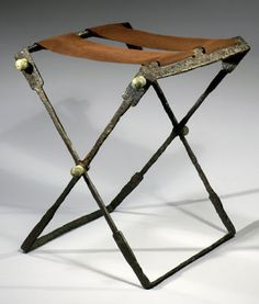 A Roman folding iron stool, seat replaced. 1st-3rd c. CE