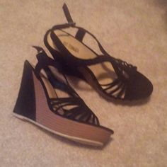New black & brown wedge heels size 8.5 New. Never worn. Size 8.5 only. No trades. Firm price. hot tomato Shoes Heels