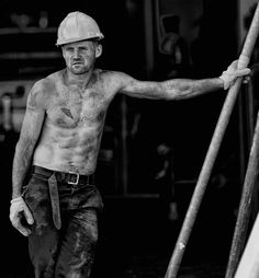 Working man, vintage. Construction site, shirtless, covered in dirt and tattoos. Face.