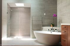 A Look at The Top Home Design Trends For 2016. The modern open master bathroom is a big trend with walk in shower and stand alone soaking tub.