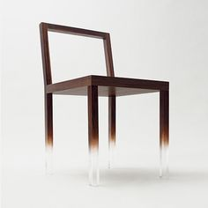Fadeout Chair by Nendo  The clear acrylic legs were specially painted by craftsmen so that the wood grain appears to gradually fade away.
