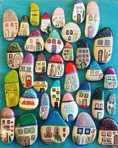 These painted rocks are so cool! They are all houses but all look so different and unique. Once you start painting these you won't want to stop! #painting #rockpainting #rocks #rockpaintingideas #houserockpainting #paintinghouses #craftgossip