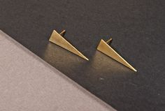 Triangle stud earrings, Spike stud earrings, Modern Gold Dagger, Triangular clip earring, geometric dainty, minimal triangle earrings    This is a beautiful 100% hand made and unique design, made by Inspirala.    • Made from pure raw italian Brass and the platting is for your personal choice between: Fine sterling silver, gold 24K, gunmetal black or antique silver.    • Size is 1.5 cm x 0.75cm.    • This beautiful piece comes in a unique gift box made from 100% recycled paperboard    • 100%…