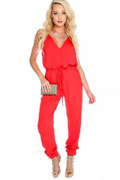 19217e3e3e6 Have all eyes on you rocking this sexy jumpsuit  features  bold color
