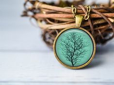 Hey, I found this really awesome Etsy listing at https://www.etsy.com/listing/187752891/tree-silhouette-necklace-tree-jewelry