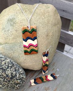 I made this with natural coloured Cherry, Holly, and Satinwood.  Four dyed veneers: black, green, fuchsia, blue. Hand sculpted with sterling silver. Zibbet
