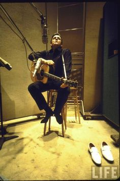Johnny Cash is as real as they come, brother.  I feel sorry for poor lil' Juaqiem Phoenix – trying to fill those big (white) shoes on screen.  The hard livin', honky tonkin', God lovin' man in black.  God rest his soul. Country/Western singer Johnny Cash in recording studio.  Nashville, TN 1969