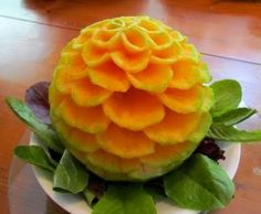 Step-by-step picture tutorial on how to carve a cantaloupe into a flower. #Fruit #Carve #Flower