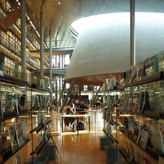 I like the glass wall/display of magazines. Great sight lines.    The Library of the University of Delft, The Netherlands, designed by the Mecanoo architects, Delft. Photography by rutger spoelstra Flickr.com