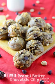 Ultimate Peanut Butter Chocolate Chip Cookies. A peanut butter lover's dream! Peanut butter cookies, stuffed with peanuts, chocolate chips, and peanut butter cups make these babies truly ULTIMATE!