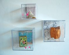These little display boxes are made from ordinary photo cubes.