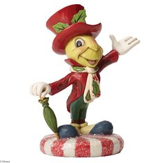 4051974 Jolly Jiminy (Jiminy Cricket)- Jiminy Cricket stands tall on a sugar coated peppermint in this festive Christmas design #Disney #Magical #Enesco