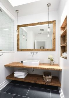 10 Tips: A Michigan Lake House by Linc Thelen - Slate flooring and a custom vanity of reclaimed wood hita subtle nautical note inthe master bath. Bad Inspiration, Bathroom Inspiration, Furniture Inspiration, Basement Bathroom, Bathroom Interior, Master Bathroom, White Bathroom, Diy Bathroom Furniture, Lake House Bathroom