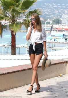 Covering up: The fashion designer then decided to cover her bikini-clad figure as she took a stroll