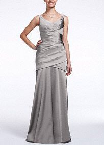 Flawless structured design, your bridesmaids will look alluring in this stunning dress!  This sleeveless high fashion stunner features a v-neckline that beautifully frames the face.  Stretch satin pleated bodice adds texture and accentuates all of your best assets.  Available in limited stores.  Lined through the hip. Back zip. Imported polyester. Dry clean only.  To protect your dress, try our Non Woven Garment Bag.