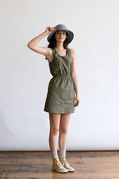 A Bridge & Burn favorite, this sporty, easy-breezy racerback dress has a bit of stretch to its breathable linen-cotton blend, a gathered waist, and inseam hand pockets. In Olive Linen. 55% Linen, 42%