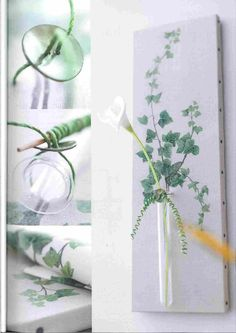 Wall flower holder- part 1. This is a decopodged (fabric or wallpaper) cut out fern picture onto a canvas. Then a glass vase or test tube is attatched with wire and a button. The excess wire is then curled in front for decoration. Add an artificial lily and hang on you wall