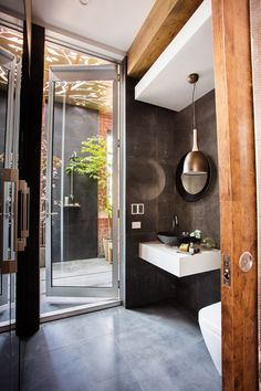 This stylish terrace and bathroom appeared on The Block Fans vs. Faves. It features the matte black Penny Round tile from Beaumont Tiles on the outdoor shower. #TheBlock
