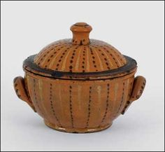 Pennsylvania redware sugar bowl and cover, ca. 1820 , with vibrant yellow