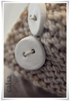 Make your own buttons out of Fimo or self drying clay.