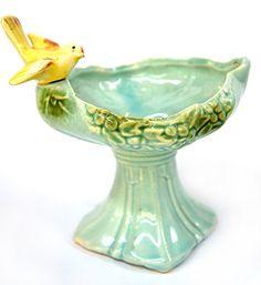 McCoy Pottery Bird Bath Feeder Circa 1940s Vintage McCoy Pottery bird bath feeder or statue depicting small yellow canary atop aqua ceramic pedestal.