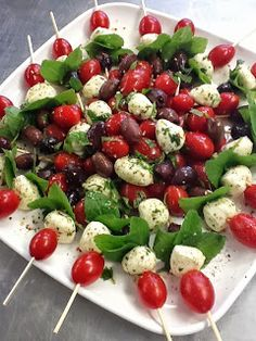 Mozzarella Caprese Bites - we love the idea of these as an hors d'oeuvre to be passed around during cocktail hour!