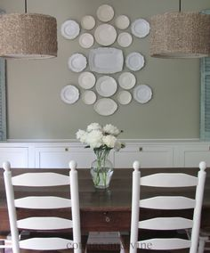Like the white plate and fun lamp shades.