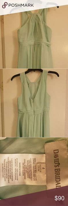 David's Bridal Bridesmaid Formal Dress This is a mint green size 4 chiffon gown from David's Bridal. It crosses in the front to meet in the back. It encloses by zipper. Worn once, in great condition! David's Bridal Dresses Wedding