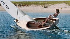 Cranked way over with foot on the tiller - E.M. Crosby Boatworks