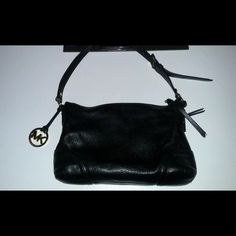 NWT MK Fallon black leather shoulder bag Please note: this is a pre owned Michael Kors purse, it measures approx 20 inches wide, excellent condition, genuine leather, this purse retails for over $250.00. Pre owned but never carried so still NWT! Michael Kors Bags Shoulder Bags